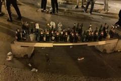 San Nicola e i due volti di Bari, dietro il corteo rimangono le bottiglie di birra vuote