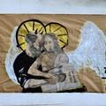 Bari, diavolo abbraccia angelo sui muri della stazione, è polemica