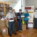 Scarpe contraffatte sequestrate al porto di Bari, la guardia di finanza le dona alle associazioni